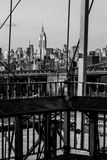 Vintage B&W look at the New York Skyline. Vintage look at the New York City skyline, from the Brooklyn Bridge. View across the river shows the Empire State royalty free stock images