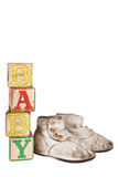 Vintage baby blocks and booties. Vintage baby booties and wooden blocks spelling baby isolated on white royalty free illustration