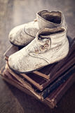 Vintage Baby Boots and Books Stock Image