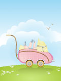 Vintage baby buggy with baby playing with its sock royalty free stock photography