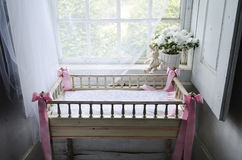 Vintage baby cot in old rural house Stock Photos