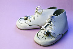 Vintage baby shoes on pink Royalty Free Stock Photography