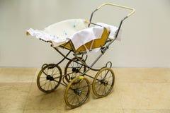 Vintage baby stroller Stock Photo