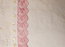Vintage background. Lace and buttons on the old paper Stock Photos
