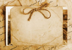 Vintage background. With old paper, letters and photos Royalty Free Stock Photo