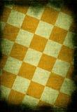 Vintage background. Chessboard style vintage background with dark edges Stock Photo