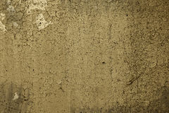 Vintage  background. Peeling paint on a wall in sepia Stock Image