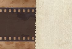 Vintage background with retro paper and old film strip Royalty Free Stock Image