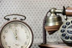 Alarm clock and old landline telephone stock image