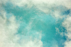 Vintage background in the blue shade with clouds Stock Images
