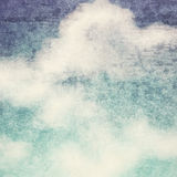 Vintage background in the blue shade with clouds Royalty Free Stock Images