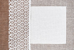 Vintage background with canvas on lace fabric and burlap Stock Images