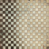 Vintage background with chequered chess ornament. Vintage abstract background with chequered chess ornament Royalty Free Stock Photography