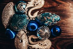 Vintage background with Christmas toys of blue and silver color royalty free stock photography