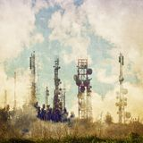 Vintage background with cloudy sky and antennas television repeaters Royalty Free Stock Image