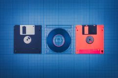 Floppy disks and mini-CD Royalty Free Stock Photos