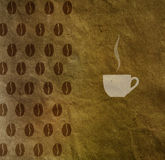 Vintage background with a cup of coffee and coffee beans pattern Stock Photos