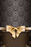 Vintage background with elegant gold bow. Royalty Free Stock Photo