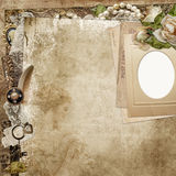 Vintage background with frame, faded roses and retro decoration Stock Photos