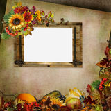 Vintage background with frame, flowers, leaves, berries and pumpkins Royalty Free Stock Images