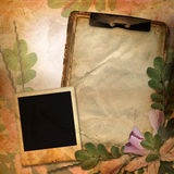 Vintage background with frame for photo. Notebook and flower composition Stock Photo