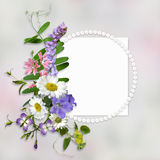 Vintage background with frame for photo or text and a bouquet of summer meadow flowers vector illustration