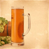 Vintage background with a glass of beer texture for any of your Royalty Free Stock Photography