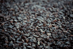 Vintage background of gravel. film grain. Texture of a wet road. One of a million. A special and outstanding object Royalty Free Stock Images