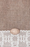 Vintage background with lace on the burlap Royalty Free Stock Images