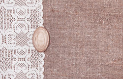 Vintage background with lace on the burlap Royalty Free Stock Image