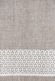 Vintage background with lace fabric on burlap Stock Images