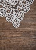 Vintage background with lace on the old wood Royalty Free Stock Photo