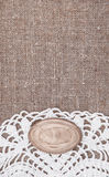 Vintage background with lace on the old burlap Royalty Free Stock Images
