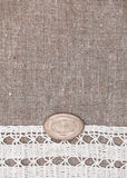 Vintage background with lace on the old burlap Stock Image