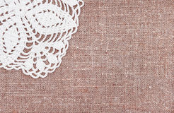 Vintage background with lace on the old burlap Royalty Free Stock Image