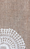 Vintage background with lace on the old burlap Royalty Free Stock Photos
