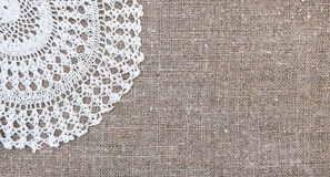 Vintage background with lace on the old burlap Royalty Free Stock Photography