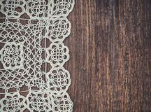 Vintage background with lace on the old wood Stock Image