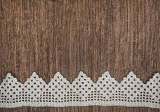 Vintage background with lace on the old wood Royalty Free Stock Image