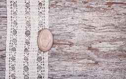 Vintage background with lace on the old wood Stock Photo