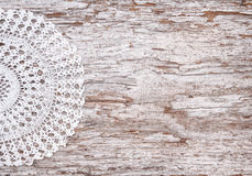 Vintage background with lace on the old wood Stock Images