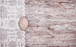 Vintage background with lace on the old wood Royalty Free Stock Images