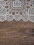 Vintage background with lace on the old wood Stock Photos