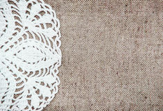 Vintage background with lacy on linen burlap texture. Vintage background with lacy on linen flax burlap texture Royalty Free Stock Photos