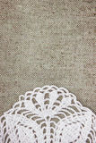 Vintage background with lacy on linen burlap texture Royalty Free Stock Photos