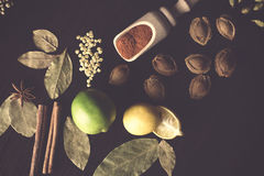 Vintage background of laid out on kitchen wooden table spices Stock Images