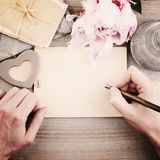 Vintage Background with Male Hands, Pen and Paper royalty free stock images