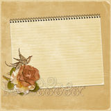 Vintage background with a notebook and a rose with Stock Photos