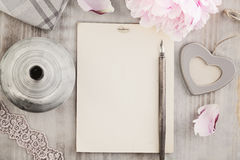 Vintage Background with Old Blank Paper, Pen and Flowers Royalty Free Stock Photos