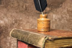 Vintage background. Old books and inkwell. royalty free stock image